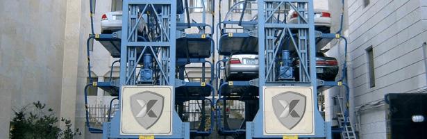 ¿Cómo bajar los vehículos adecuadamente de los elevadores?